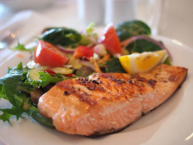 Image a dinner plate with salmon and vegetables.